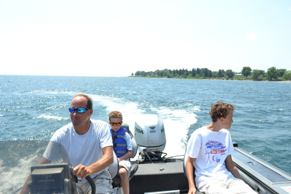 Chris Cinelli captains the sport fishing boat on Lake Erie with his two of his sons, Parker (left) and Connor (right).