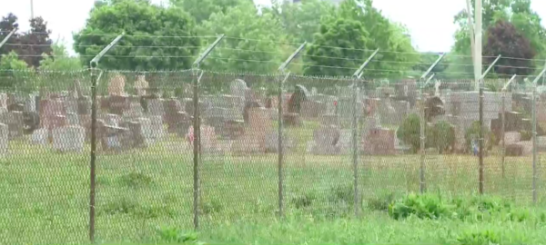 EPA in April fenced off the contaminated property at Holy Trinity Cemetery.